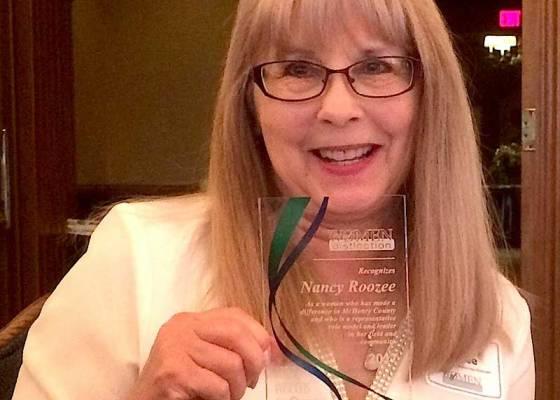 Nancy with Woman of Distincton Award